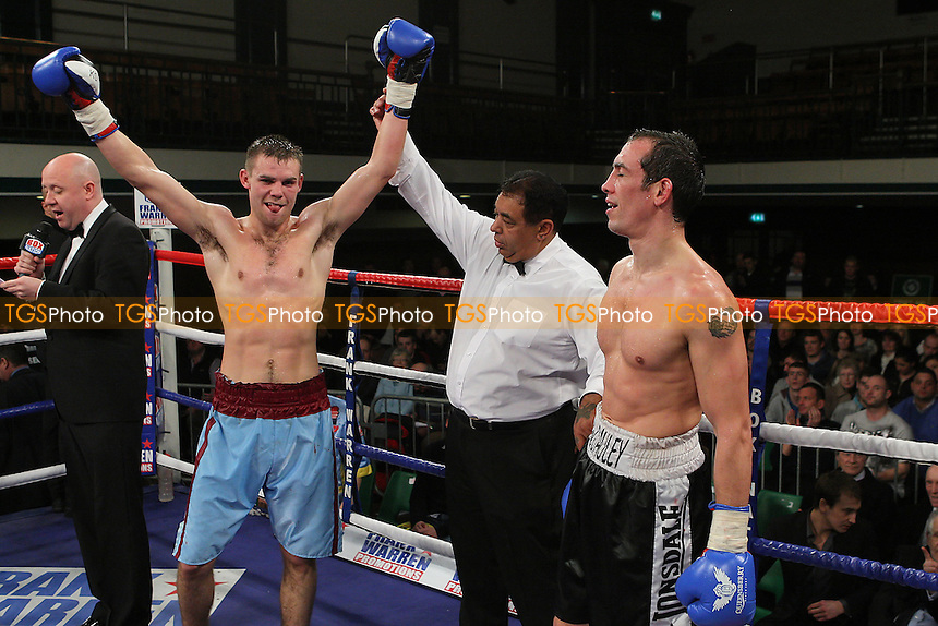 Freddie Turner (blue shorts) defeats Kevin McCauley in a Welterweight boxing contest at York Hall, Bethnal Green, promoted by Frank Warren - 14/12/11 - MANDATORY CREDIT: Gavin Ellis/TGSPHOTO - Self billing applies where appropriate - 0845 094 6026 - contact@tgsphoto.co.uk - NO UNPAID USE.