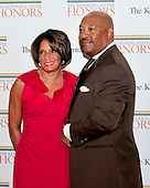 James A. Bell, corporate president, chief financial officer and an executive vice president of The Boeing Company, and his wife, arrive for the formal Artist's Dinner honoring the recipients of the 2011 Kennedy Center Honors hosted by United States Secretary of State Hillary Rodham Clinton at the U.S. Department of State in Washington, D.C. on Saturday, December 3, 2011. The 2011 honorees are actress Meryl Streep, singer Neil Diamond, actress Barbara Cook, musician Yo-Yo Ma, and musician Sonny Rollins..Credit: Ron Sachs / CNP