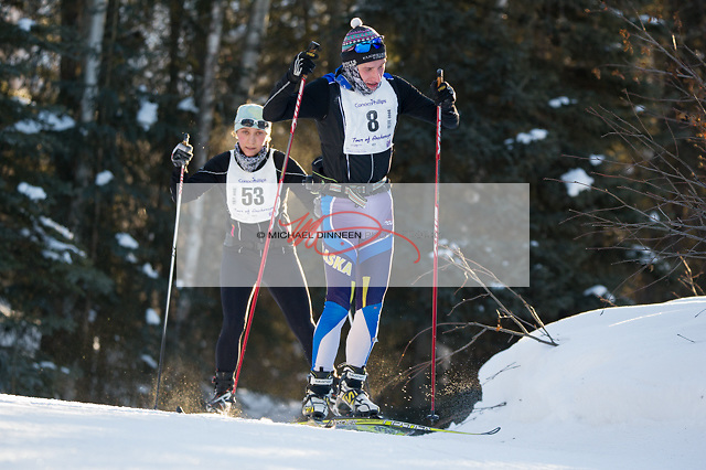 From left, Kinsey and Alex Loan ski in the Tour of Anchorage ski race Sunday, March 5, 2017.