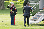United States President Barack Obama salutes the Marine Guard as he boards Marine 1 to depart the South Lawn of the White House in Washington, DC en route to Camden, New Jersey to make remarks on creating safer communities on Monday, May 18, 2015.<br /> Credit: Ron Sachs / Pool via CNP