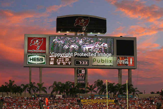 The sun sets over Raymond James Stadium with the Tampa Bay Buccaneers in the lead in the fourth quarter.  The Buccaneers defeated the Saints 26-20 in an NFL game, Sunday, Oct. 16, 2011 in Tampa, Fla. (AP Photo/Margaret Bowles)