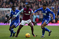 Albert Adomah of Aston Villa is surrounded by Jeremie Boga of Birmingham and David Davis of Birmingham during the Sky Bet Championship match between Aston Villa and Birmingham City at Villa Park, Birmingham, England on 11 February 2018. Photo by Bradley Collyer/PRiME Media Images.