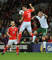 Wales'  Sam Vokes beats Ireland's Glenn Whelan to the header <br /> <br /> Photographer Ian Cook/CameraSport<br /> <br /> FIFA World Cup Qualifying - European Region - Group D - Wales v Republic of Ireland - Monday 9th October 2017 - Cardiff City Stadium - Cardiff<br /> <br /> World Copyright &copy; 2017 CameraSport. All rights reserved. 43 Linden Ave. Countesthorpe. Leicester. England. LE8 5PG - Tel: +44 (0) 116 277 4147 - admin@camerasport.com - www.camerasport.com