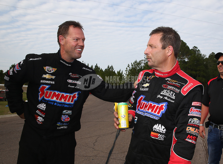 Mar 15, 2015; Gainesville, FL, USA; NHRA pro stock driver Greg Anderson (right) is congratulated by teammate Jason Line after winning the Gatornationals at Auto Plus Raceway at Gainesville. Mandatory Credit: Mark J. Rebilas-