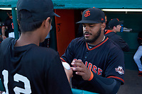 San Jose Giants outfielder Heliot Ramos (13) signs an autograph before a California League game against the Visalia Rawhide on April 12, 2019 at San Jose Municipal Stadium in San Jose, California. Visalia defeated San Jose 6-2. (Zachary Lucy/Four Seam Images)