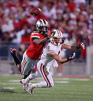Wisconsin Badgers wide receiver Jared Abbrederis (4) tries to catch a pass while defended closely by Ohio State Buckeyes cornerback Bradley Roby (1) during Saturday's NCAA Division I football game at Ohio Stadium in Columbus on September 28, 2013. (Barbara J. Perenic/Columbus Dispatch)
