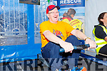 Fr Padraig Walsh rowing for Banna Sea Rescue and Kerry Mountain Rescue fundraiser in Nolans Garage on Saturday.