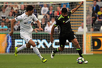 (L-R) Federico Fernandez of Swansea City chases Diego Costa of Chelsea during the Premier League match between Swansea City and Chelsea at The Liberty Stadium on September 11, 2016 in Swansea, Wales.