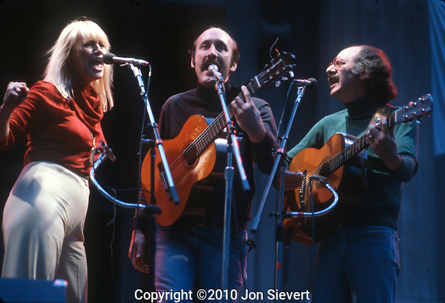 "Peter Paul & Mary, Oct 1989, Bread & Roses, Greek Theater, Berkeley, American folk-singing trio who ultimately became one of the biggest acts of the 1960s. The trio was composed of Peter Yarrow, Paul Stookey, and Mary Travers. They were one of the first groups to record Bob Dylan's songs, gaining a huge hit with ""Blowin' In The Wind."" Other hits included ""If I Had a Hammer,"" ""Puff the Magic Dragon,"" and ""Leaving on a Jet Plane."