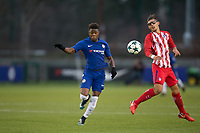 Daishawn Redan of Chelsea moves past Fransisco Montero of Atletico Madrid during the UEFA Youth League group match between Chelsea and Atletico Madrid Juvenil A at the Chelsea Training Ground, Cobham, England on 5 December 2017. Photo by Andy Rowland.