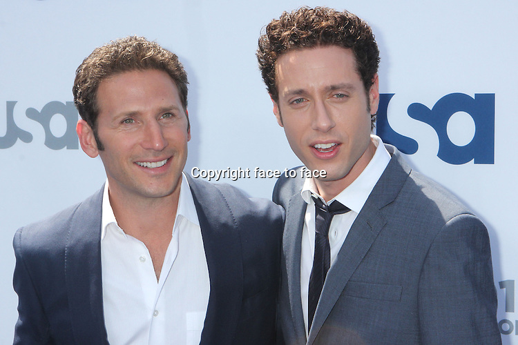 Mark Feuerstein and Paulo Costanzo arriving at the USA Network's 2013 Upfront at Basketball City at Pier 36 in New York, 16.05.2013. Credit: Rolf Mueller/face to face