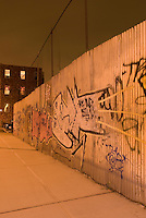 Graffiti Spray Painted on a Metal Wall in the Williamsburg section of Brooklyn, Night, New York City, New York State, USA
