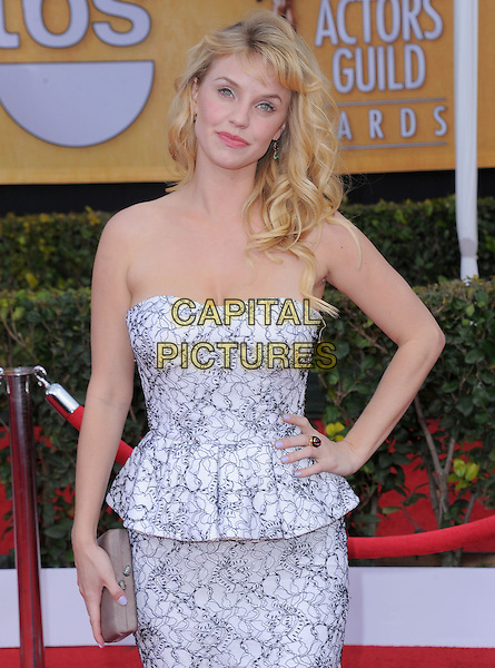Kelli Garner.Arrivals at the 19th Annual Screen Actors Guild Awards at the Shrine Auditorium in Los Angeles, California, USA..27th January 2013.SAG SAGs half length hand on hip white lace black strapless peplum dress hand on hip clutch bag beige .CAP/DVS.©DVS/Capital Pictures.
