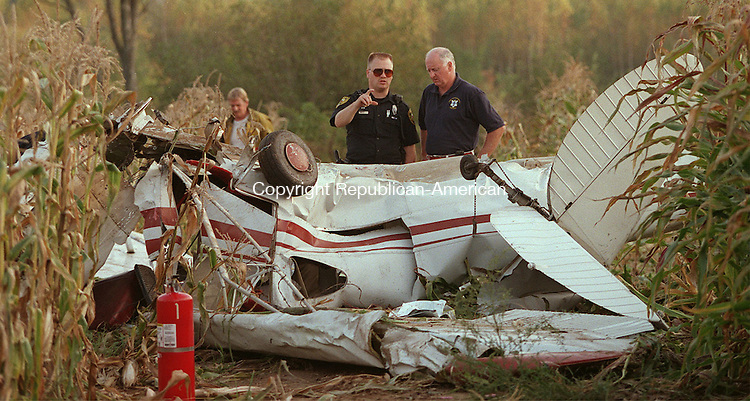 WATERTOWN, CT 09/26/98--0926CA02.tif  (left to right) Watertown police officer Todd Robinson and Police Chief Jack Carroll investigate the crash scene where two people were injured when this airplane crashed in a corn field on Gustafson Farm in Watertown. (NEED NAME OF FARM)--CRAIG AMBROSIO staff  / STAND ALONE PHOTO  (Filed in Scans/Scan-In)