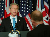 Washington, D.C. - December , 2006 -- Reuters' White House Correspondent Steve Holland, right, asks a question of United States President George W. Bush during a joint press conference at the White House with Prime Minister Tony Blair of Great Britain hold  in Washington, D.C. on Thursday, December 7, 2006..Credit: Ron Sachs / CNP