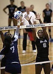 Marymount's Margaret McAlpin and Morgan McAlpin block in a college volleyball game, in Arlington, Vir., on Saturday, Nov. 1, 2014.<br /> Photo by Cathleen Allison