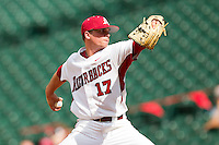 Relief pitcher Barrett Astin #17 of the Arkansas Razorbacks in action against the Texas Tech Red Raiders at Minute Maid Park on March 2, 2012 in Houston, Texas.  The Razorbacks defeated the Red Raiders 3-1. (Brian Westerholt/Four Seam Images)