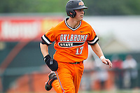 Oklahoma State Cowboys catcher Gage Green #17 runs to third base during the NCAA baseball game against the Texas Longhorns on April 26, 2014 at UFCU Disch–Falk Field in Austin, Texas. The Cowboys defeated the Longhorns 2-1. (Andrew Woolley/Four Seam Images)