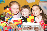 PICTURE PERFECT: Students from Meenkilly National School in Abbeyfeale enjoyinga Jumble Sale at the school on Friday afternoon to raise funds for the Abbeyfeale and Templeglantine Cherynoble Groups..L/r.Jennifer Leonard, Emily McCarthy and Laura Stack.   Copyright Kerry's Eye 2008