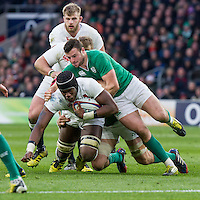 Maro Itoje tackled by Robbie Henshaw, England v Ireland in a 6 Nations match at Twickenham Stadium, Whitton Road, Twickenham, England, on 27th February 2016