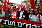 "Knesset members of Chadash march in Tel Aviv holding a sign :""Jews and Arabs refuse to be ennemies"".Thousands gathered to protest the Israeli raid on a Gaza-bound aid ship earlier this week, in which nine pro-Palestinian activists were killed. Photo by Quique Kierszenbaum."