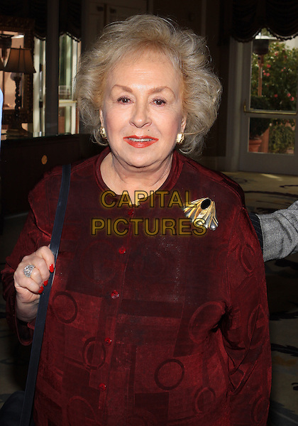 DORIS ROBERTS.Pre-Oscar Gifting Suite Of 100 Stars held at The Beverly Hills Hotel, Beverly Hills, California, USA..February 23rd, 2010.half length red maroon burgundy top brooch velvet .CAP/ADM/TC.©T. Conrad/AdMedia/Capital Pictures.