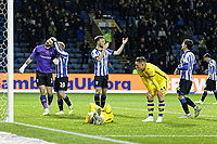 Barry Bannan of Sheffield Wednesday (2nd L) congratulates Keiren Westwood of Sheffield Wednesday (L) for saving the ball from a Swansea attack involving Connor Roberts of Swansea City during the Sky Bet Championship match between Sheffield Wednesday and Swansea City at Hillsborough Stadium, Sheffield, England, UK. Saturday 09 November 2019