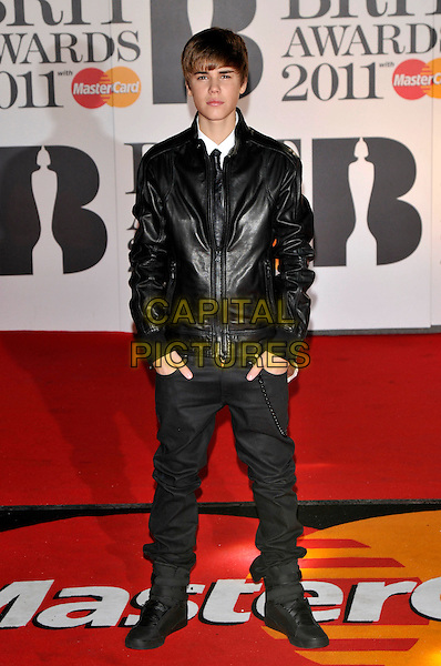 JUSTIN BIEBER .The BRIT Awards 2011 at the O2 Arena, London, England..February 15th, 2011 .brits full length black leather jacket trousers hands in pockets .CAP/PL.©Phil Loftus/Capital Pictures.