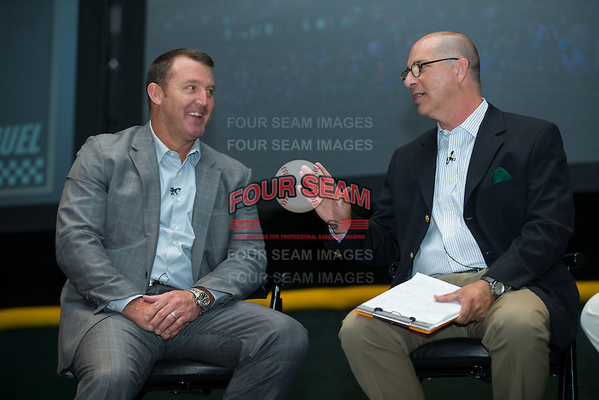 Jim Thome talks with Matt Swierad, radio voice of the Charlotte Knights, at the Triple-A All-Star Game Luncheon at the Charlotte Convention Center on July 12, 2016 in Charlotte, North Carolina.  Thome was inducted into the Charlotte Baseball Roundtable of Honor along with his former Charlotte Knights manager, Charlie Manuel (not pictured).   (Brian Westerholt/Four Seam Images)