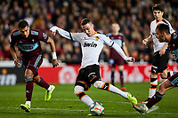 1st February 2020; Mestalla, Valencia, Spain; La Liga Football,Valencia versus Celta Vigo; Rodrigo Moreno of Valencia CF shoots as Jeison Murillo of Celta closes in