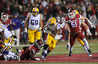 NWA Media/ANDY SHUPE - Arkansas' Braylon Mitchell, left, reaches to tackle LSU's Terrence Magee (18) during the third quarter Saturday, Nov. 15, 2014, at Razorback Stadium in Fayetteville.