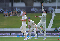 England's Sam Curran watches England's Rory Burns leap for the ball as England's Ben Stokes (centre) looks on during day five of the international cricket 2nd test match between NZ Black Caps and England at Seddon Park in Hamilton, New Zealand on Tuesday, 3 December 2019. Photo: Dave Lintott / lintottphoto.co.nz