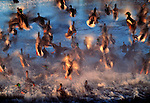 An explosion of water and wings fills this image as a flock of wild mallards erupt off the surface of a tidal pond along British Columbia's Fraser River Delta. Wary of both man and predatory falcons and eagles, these ducks instantly react to the slightest movement.