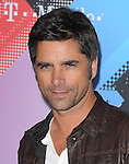 John Stamos at The T-Mobile Sidekick 4G Launch Party held at a private lot in Beverly Hills, California on April 20,2011                                                                               © 2010 Hollywood Press Agency