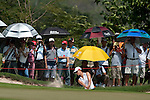 CHON BURI, THAILAND - FEBRUARY 19:  Michelle Wie of USA plays a bunker shot on the 7th hole during day three of the LPGA Thailand at Siam Country Club on February 19, 2011 in Chon Buri, Thailand. Photo by Victor Fraile / The Power of Sport Images