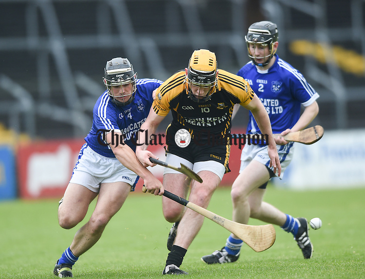 Niall Deasy of Ballyea in action against David Ryan and Shane O Leary of Cratloe during their match in Ennis. Photograph by John Kelly.