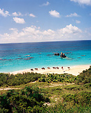 BERMUDA, Horseshoe Bay, tourists horseback riding on coastline