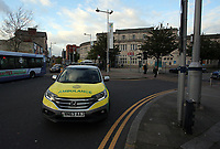 Pictured: An ambulance by the railway station. Friday 28 April 2017<br />Re: A man who threatened to jump off a bridge connecting the railway station and the High Street car park in, Swansea, south Wales has been removed by police officers.
