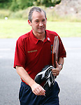 George Burley arrives at Scotland training with his dossier of information