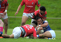 Jarrod Adams tries to hold onto the ball during the Village Kings 10s rugby tournament  match between Aiga Malisi (red) and Wellington Samoan (blue) at Jerry Collins Stadium in Porirua, New Zealand on Saturday, 21 October 2017. Photo: Dave Lintott / lintottphoto.co.nz