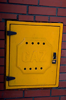 Yellow door covering a gas connection in Poland. Rawa Mazowiecka Central Poland