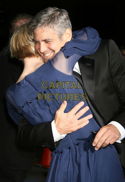 "RENEE ZELLWEGER & GEORGE CLOONEY .""Leatherheads"" World Premiere held at Grauman's Chinese Theatre, Hollywood, California, USA,.31 March 2008..half length blue sheer dress back behind hugging embracing  around waist .CAP/ADM/RE.©Russ Elliot/Admedia/Capital PIctures"