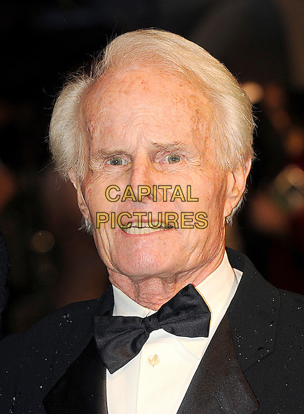 RICHARD D. ZANUCK.Royal World Film Premiere of 'Alice in Wonderland' at the Odeon cinema, Leicester Square, London, England, UK, 25th February 2010 .arrivals portrait headshot white black bow tie tuxedo tux .CAP/BEL.©Tom Belcher/Capital Pictures.