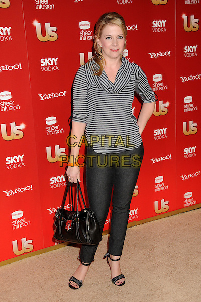 MELISSA JOAN HART.US Weekly's Hot Hollywood Party 2009 held at Voyeur, West Hollywood, California, USA..November 18th, 2009.full length cowel neck top hand on hip jeans denim bag purse grey gray black striped stripes .CAP/ADM/BP.©Byron Purvis/AdMedia/Capital Pictures.
