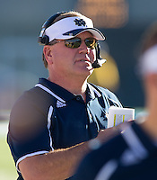Brian Kelly watches from the sideline in the second quarter .