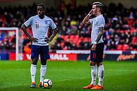 Fulham's midfielder Ryan Sessegnon (11) for England U21's  and Norwich City's forward James Maddison (10) for England U21's  stand over the free kick during the International Euro U21 Qualification match between England U21 and Ukraine U21 at Bramall Lane, Sheffield, England on 27 March 2018. Photo by Stephen Buckley / PRiME Media Images.