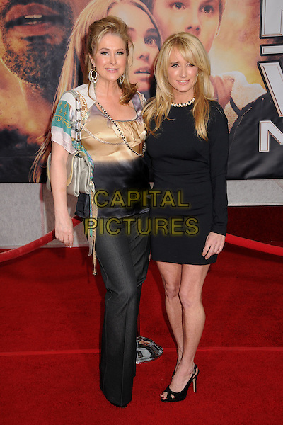 "KATHY HILTON & KIM RICHARDS.""Race to Witch Mountain"" Los Angeles Premiere at the El Capitan Theatre, Hollywood, California, USA..March 11th, 2009.full length green grey gray yellow bag purse black trousers gold silk satin blouse top white green dress.CAP/ADM/BP.©Byron Purvis/AdMedia/Capital Pictures."