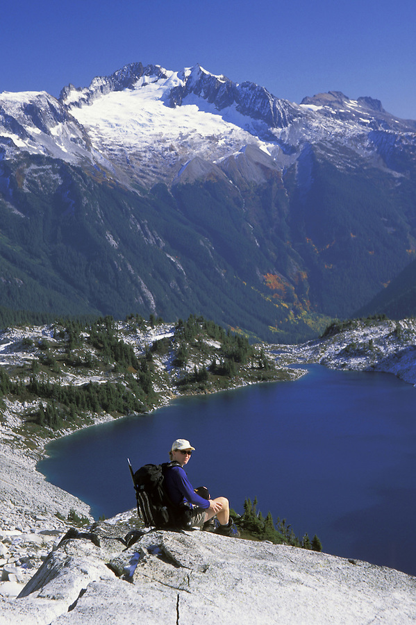 Hiker sitting above Hidden Lake, Hidden Lake Trail, North Cascades National Park, Cascade Mountains, Washington