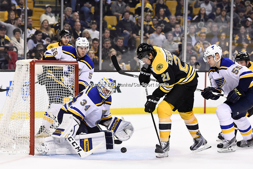 Tuesday, December 22, 2015: Boston Bruins left wing Loui Eriksson (21) takes a shot on St. Louis Blues goalie Jake Allen (34) during the National Hockey League game between the St. Louis Blues and the Boston Bruins held at TD Garden, in Boston, Massachusetts. The blues beat the Bruins 2-0 in regulation time. Eric Canha/CSM