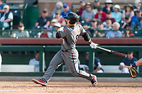 Salt River Rafters designated hitter Daulton Varsho (8), of the Arizona Diamondbacks organization, follows through on his swing during the Arizona Fall League Championship Game against the Peoria Javelinas at Scottsdale Stadium on November 17, 2018 in Scottsdale, Arizona. Peoria defeated Salt River 3-2 in 10 innings. (Zachary Lucy/Four Seam Images)